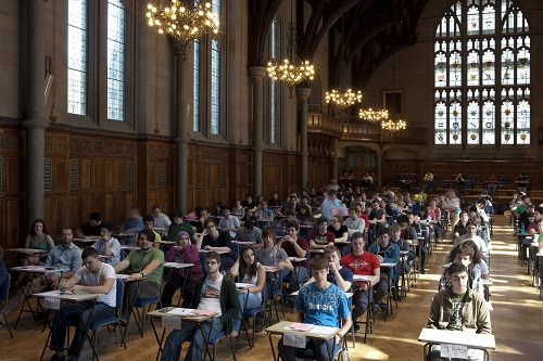 Students doing exams in exam hall