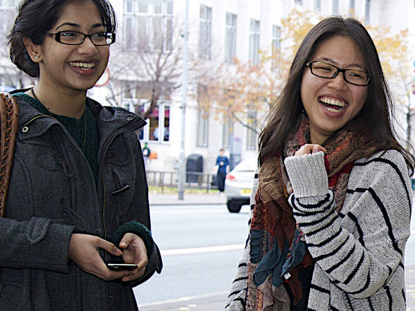 Two students laughing outside